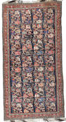 A North West Persian rug 10 ft 9 in x 5 ft 4 in (328 x 163 cm)localised small hole