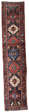 A North West Persian runner 13 ft 9 in x 2 ft 10 in (419 x 87 cm)