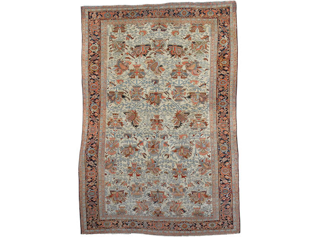 A Heriz carpet North West Persia, 11 ft 5 in x 7 ft 10 in (348 x 239 cm)some minor wear