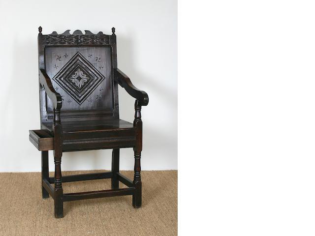 A Charles II oak open armchair