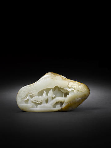 A pale green carved jade boulder  18th century