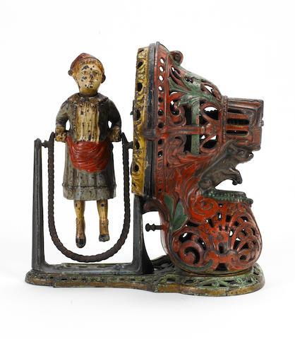 A J & E Stevens Co. cast iron Girl Skipping Rope clockwork bank