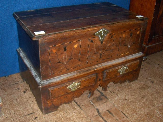 An 18th century oak and inlaid coffer bach