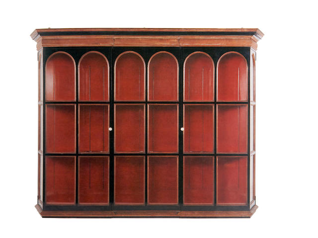 An early 20th century ebonised hanging display cabinet,