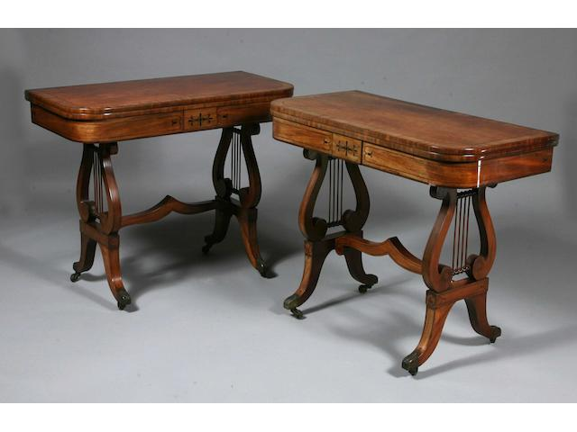A pair of Regency period mahogany card tables