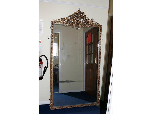 A mid 19th century gilt wood over mantle mirror
