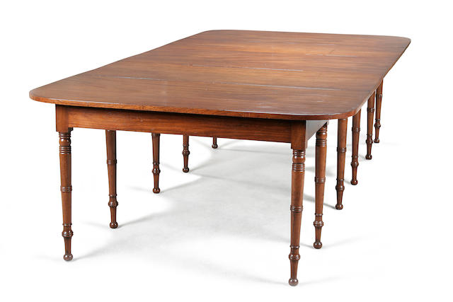A good Regency mahogany extending dining table circa 1810