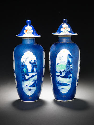 A pair of blue and white powder-blue-ground cylindrical vases and associated covers Kangxi