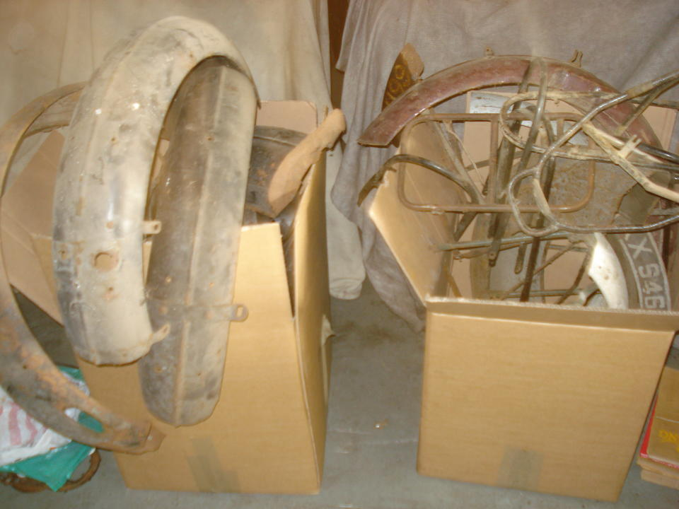 A large assortment of motorcycle mudguards,