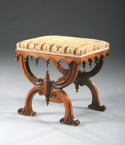 A Victorian carved walnut X-frame dressing stool