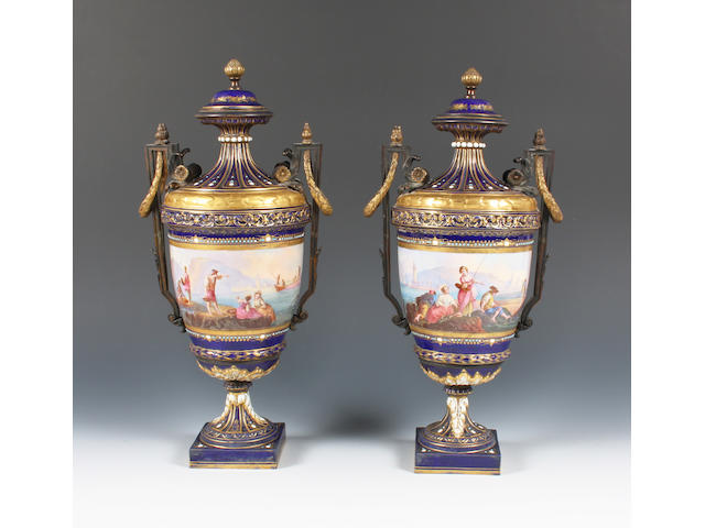 A pair of Sèvres style vases and covers with ormolu mounts