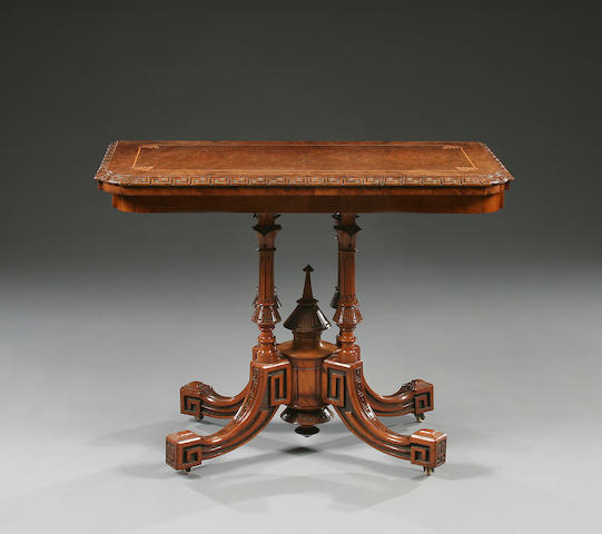 An early Victorian figured walnut fold over card table, in the Greek taste