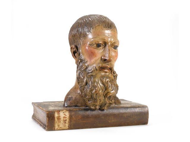 A 16th century Italian carved limewood and polychrome decorated portrait bust of Cyprianus, Bishop of Carthage