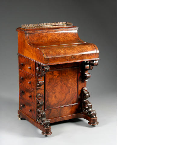 A mid Victorian figured walnut piano top davenport,