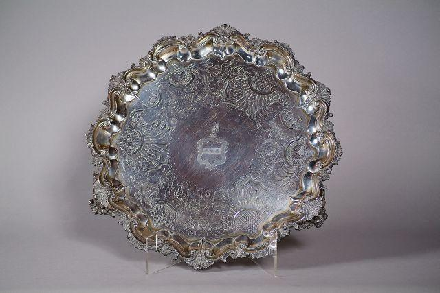 A large Sheffield silver tray with piecrust border and armorial