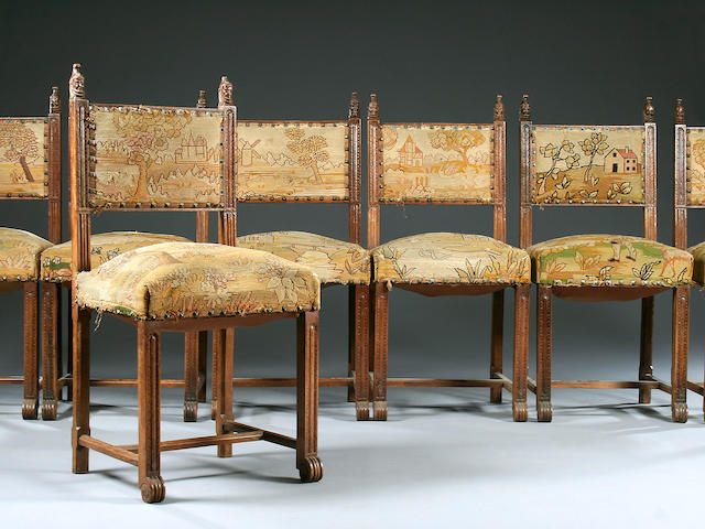 A set of twelve Continental carved walnut dining chairs, late 19th Century,