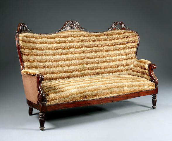 A large Continental mahogany framed sofa, circa 1830,