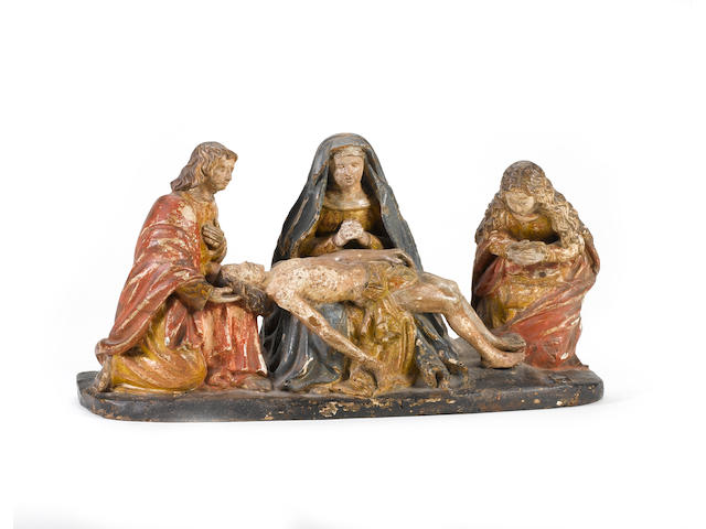 A Northern French Late Gothic carved walnut and polychrome decorated figural group of the Pietacirca 1480-1520