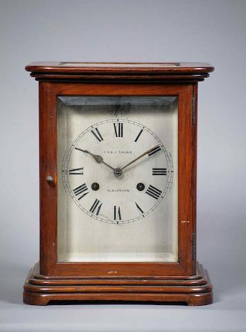 An early 20th Century mahogany-cased four glass mantel clock R.S.M., Germany; Retailed by R.H. & J. Sagar, Blackburn sold with pendulum and winder