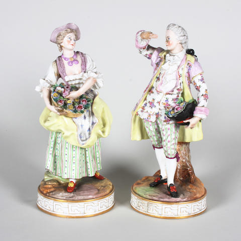 A pair of French porcelain figures of a gallant and companion Late 19th Century