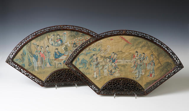 A pair of century fan-shaped silk panels 19th century
