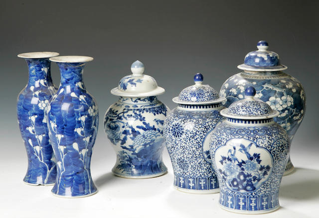 A pair of Chinese 19th century blue and white vases and covers