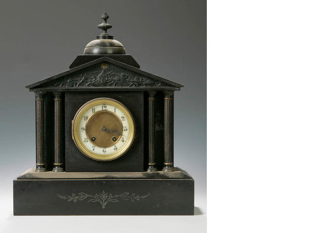 A 19th century architectural black slate mantel clock