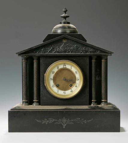 A 19th century architectural black slate mantel clock