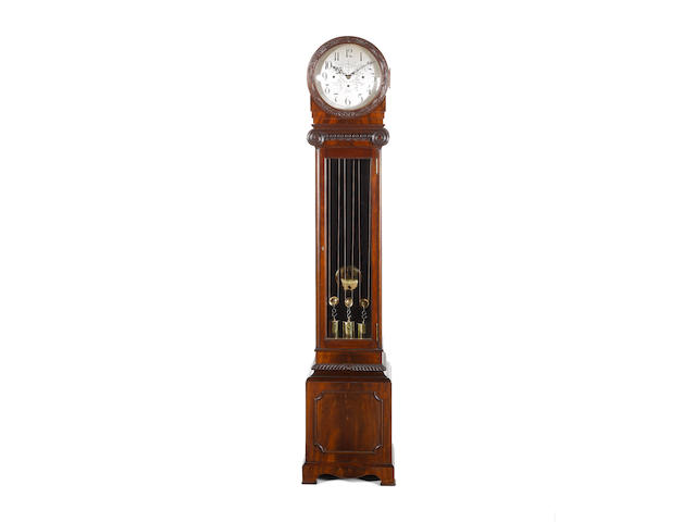 An early 20th century quarter chiming mahogany longcase clock