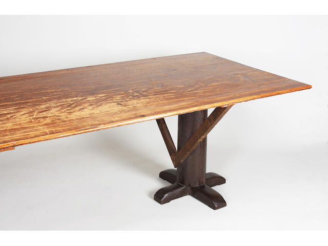 A 19th century stained pine trestle refectory type table