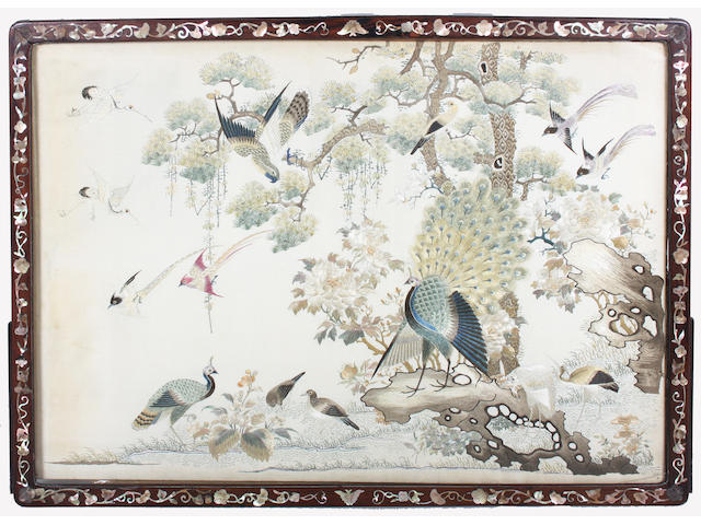 A Japanese inlaid hardwood screen enclosing an embroidered silk picture