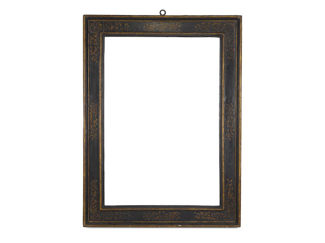 An Italian 16th Century ebonised and parcel gilt cassetta frame