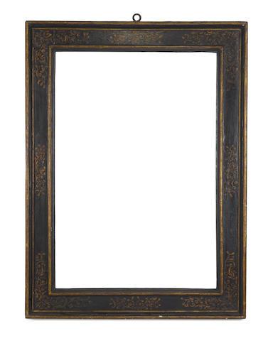 An Italian 16th Century ebonised and parcel gilt cassetta frame