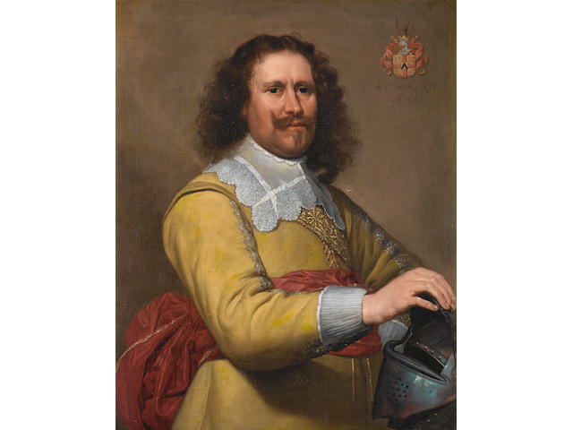 Attributed to Gerrit van Honthorst (Utrecht 1590-1656) Potrait of a gentleman, half-length, with a y