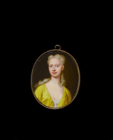 Christian Friedrich Zincke (German, 1683/4-1767) A Lady, wearing yellow robe over white chemise, her curling fair hair worn long