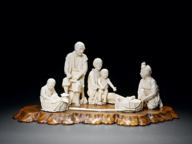 A large and elaborate Tokyo school ivory sculptural group of farmers Attributed to Ishii Masanobu/Shoshin, Meiji Period