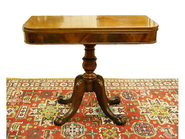 A William IV mahogany fold-over tea table