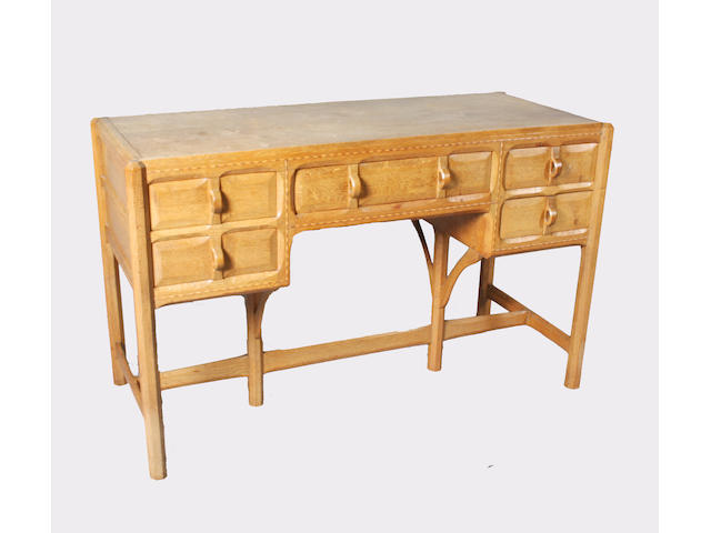 A Gordon Russell oak kneehole dressing table, matching to the previous lot, designed by Gordon Russell, No. 178, 1924