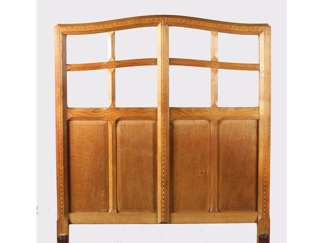A pair of Gordon Russell oak single beds, matching to the previous lot, designed by Gordon Russell, No. 179, 1924