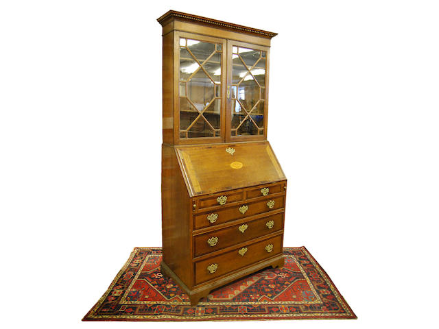 An oak and mahogany-crossbanded bureau bookcase, early 19th Century