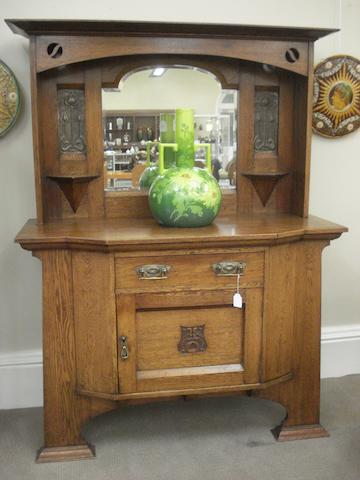 British, circa 1910 An Art Nouveau oak sideboard