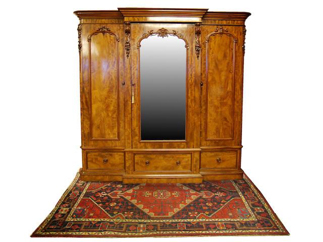 A mid-Victorian figured mahogany breakfront triple wardrobe