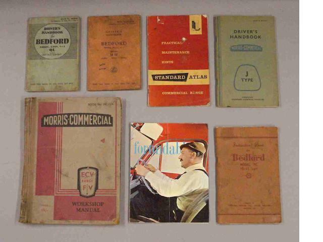 Assorted instruction books for commercial vehicles,