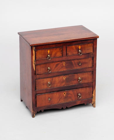 Miniature furniture: a Victorian mahogany chest of two short and three long drawers