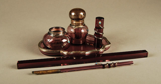 A French silver mounted amethyst glass desk set by Maria Remy, Paris (fl. 1894-1924)