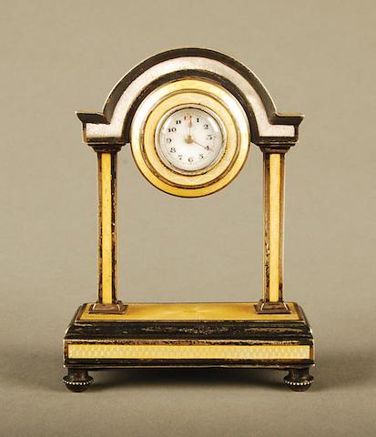 An Austrian silver gilt and enamel boudoir clock bearing 900 standard, 1866-1922 control marks