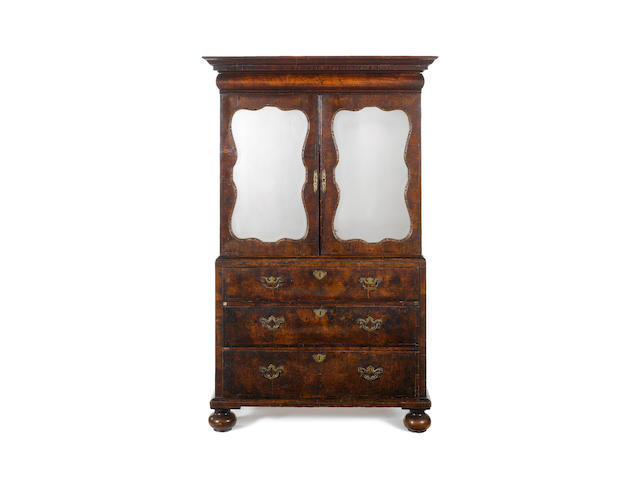 An early 18th century and later walnut cabinet on chest