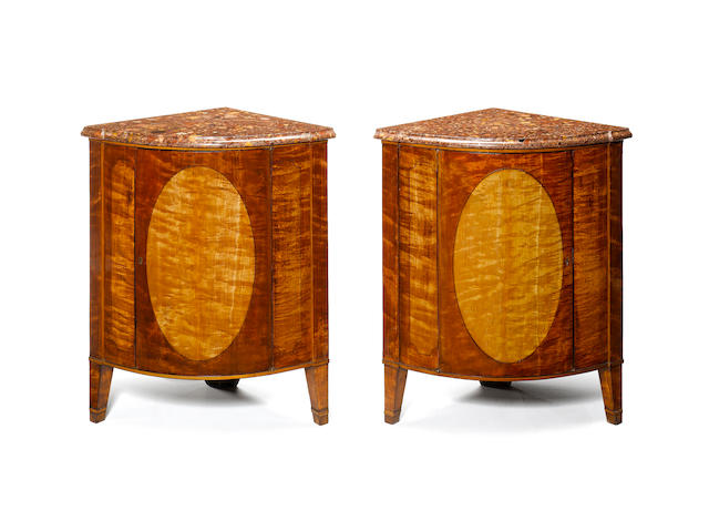 A pair of George III satinwood and ebony inlaid Encoignures