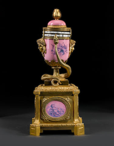 A French late 19th century Louis XVI style ormolu-mounted pink-ground Sèvres style rotary clock