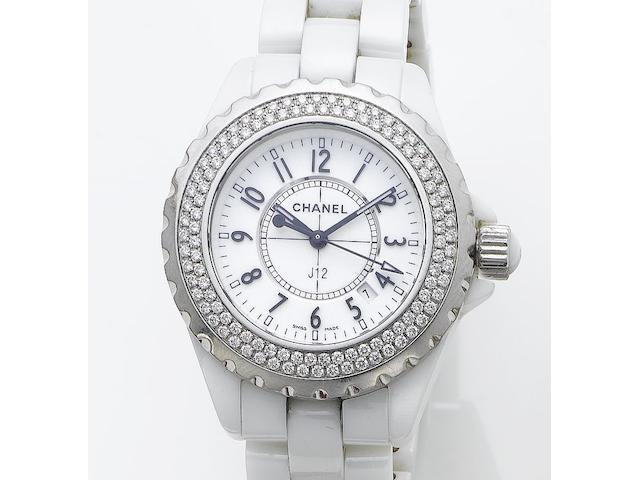 Chanel. A fine lady's white ceramic diamond set centre seconds calendar bracelet watch together with fitted box and papers  J12, Sold 17th December 2006
